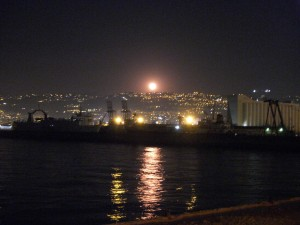 Beirut at night with a large moon